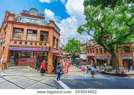 TAIPEI TAIWAN - JUNE 29: This is the entrance to Shenkeng old street a traditional old street which features old chinese arhcitecture and tradititonal shops and restaurants on June 29 2017 in Taipei