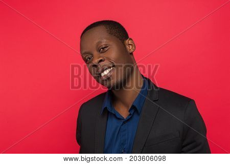 Flirty young African American man. Seductive emotion of guy. Sexual hints, romantic mood for youth, love relationship concept