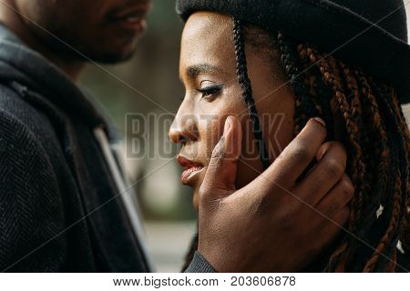 Gentle touch. Tender love relationship. Unrecognizable black couple in selective focus, young beautiful people, kindness concept