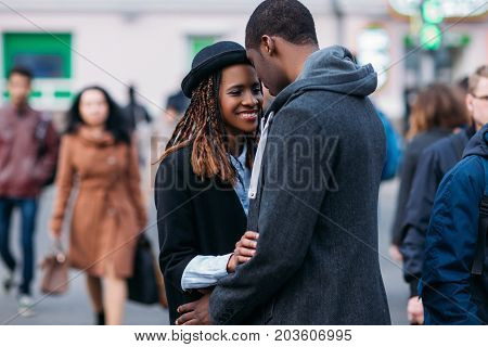 Happy romantic couple on crowd background. Joyful African American. Stylish black people meeting on street, youth relationships, love concept