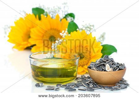 Sunflower oil and seeds on white background.