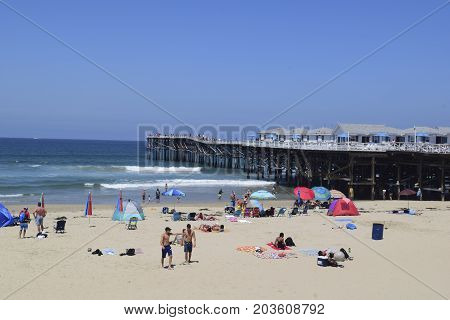 San Diego California USA - July 3 2017: Tourists and locals alike enjoying a nice sunny summer day at the Beach. Editorial use only