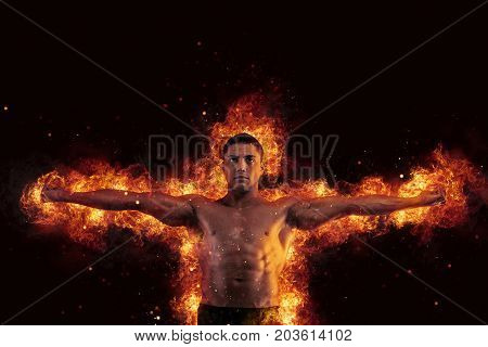 Body building trainer shows his power muscles with fire