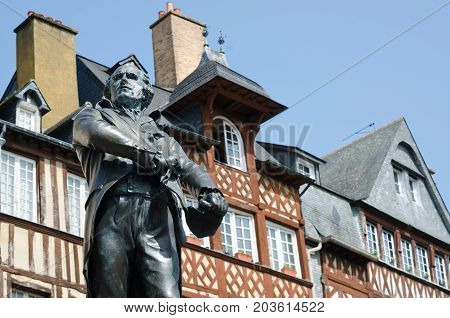 RENNES BRITTANY. August 27th 2017. The statue of Mayor Jean Leperdit keeps watch over Champ-Jacquet square in the old town of Rennes Brittany.