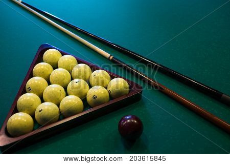Russian billiards white balls, cue ball, wooden cue on a large table with green cloth. Start of game