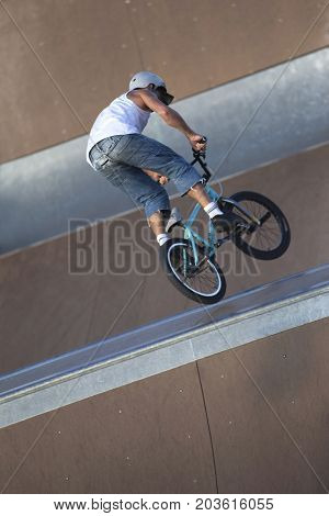 Young biker in action in a skatepark