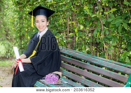 Portrait Of Happy Young Female Graduates In Academic Dress