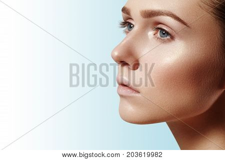Beautiful young woman with perfect clean shiny skin natural fashion makeup. Close-up woman fresh spa look. Healthy beauty