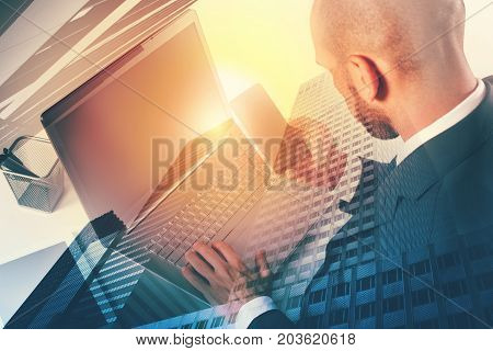 Businessperson in a office connected on internet network with a modern laptop