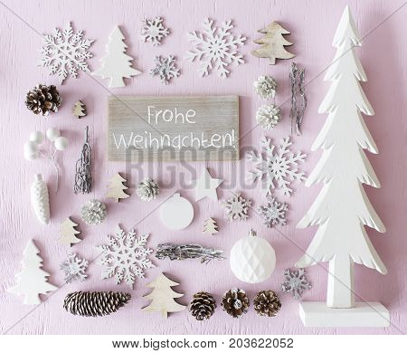 Sign With German Text Frohe Weihnachten Means Merry Christmas. Flat Lay Of Christmas Decoration Like Tree, Ball, Star And Fir Cone. Rose Quarty Wooden Background