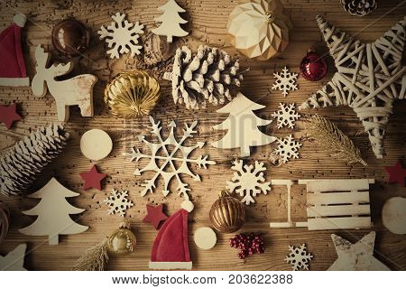 Flat Lay With Many Christmas Decoration, Like Ball, Sleigh, Fir Cone And Tree. Vintage Rustic Wooden Background With Instagram Filter And Frame