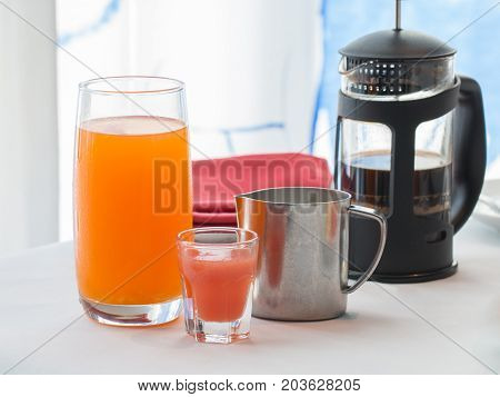 coffee and orange juice on whit table for breakfast.