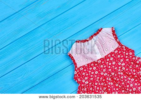Cute sleeveless baby dress. Cotton vintage colorful baby-girl dress and copy space. Image of casual toddlers beautiful dress.