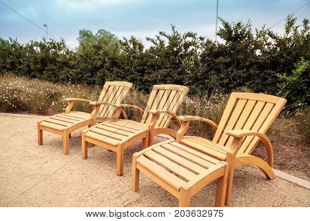 Wood Patio Lounge Chairs In The Backyard
