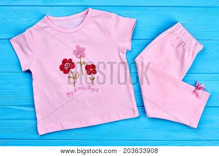 New cotton clothes for toddler girl. Top view of natural summer clothing for little girl. Beautiful cotton summer suit for baby-girl.