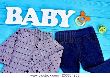 Infant boy clothes and accessories. Baby-boy autumn fashion background. Kids fashion style. Baby-boy clothes on sale.