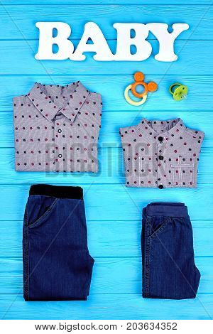 Baby-boy fashion clothes background. Cute spring or autumn garment for toddlers boy, top view. Fashionable brand apparel for little boys, accessories.