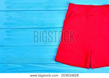 High quality red shorts for kids. Children colored shorts for casual wear, copy space. Kids brand short pants on sale.