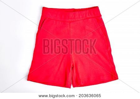 Kids red cotton shorts. Brand organic shorts for childrens isolated on white background. Kids casual clothes for summer wear.