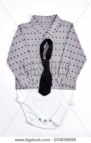 Baby-boy fashion shirt bodysuit. Toddler boy trendy cotton bodysuit and black tie isolated on white background. Toddler boy fashion apparel.