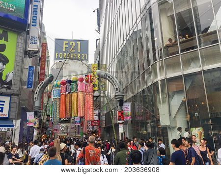 TOKYO JAPAN - July 26 2017 : Shibuya shopping street district in Tokyo Japan. Shibuya is known as one of the fashion centers of Japan for young people and as a major nightlife area.