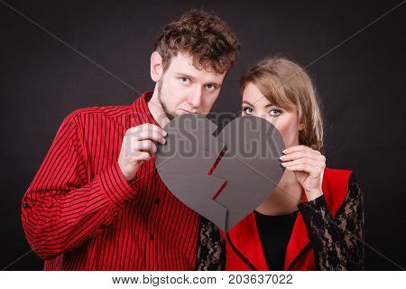 Sad Couple Holds Broken Heart.