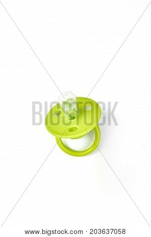 Baby silicone pacifier in green color. Baby green pacifier with rubber soother isolated on white background. Baby pacifier with ring on sale.