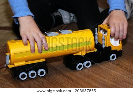 A Child Plays With A Toy Truck, Hands