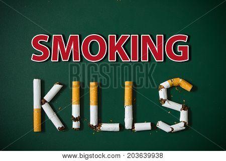 Smoking kills wording isolated on green background