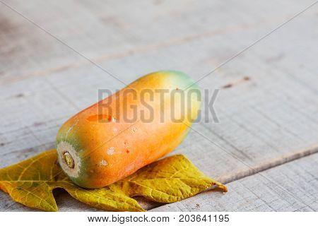 Papaya is ripe on old wooden floor.