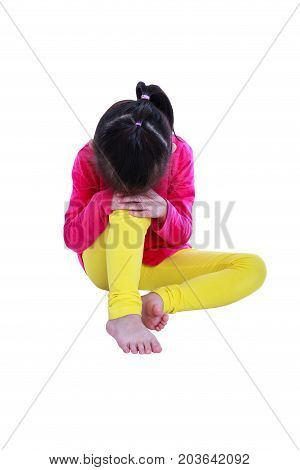 Lonely asian girl barefoot sitting on floor and sad gesture. Isolated on white background. Negative human emotions. Conceptual about children who lack warmth and affection abandoned children.