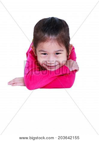 Closeup adorable asian child smiling and lie down with copy space. Happily girl in pink long sleeves shirt looking at camera. Studio shot. Isolated on white background.