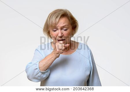 Distressed Senior Woman Coughing
