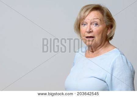 Astonished Senior Woman Looking At The Camera