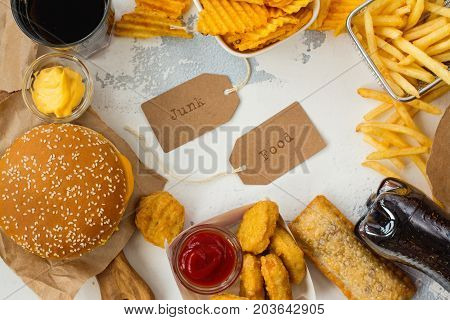 Junk food on table. Fast carbs not good for health, heart and skin. Space for text