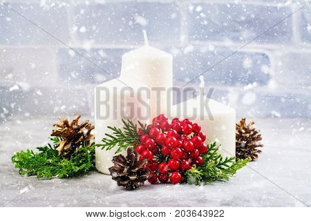 Christmas compositions with candles and cedar branches, holidays background. Space for text