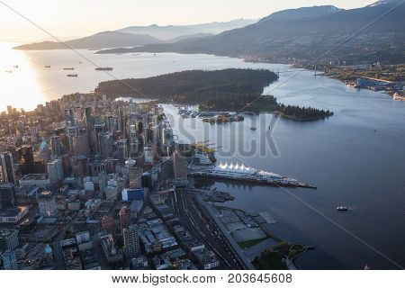 Beautiful Aerial View of Vancouver Downtown British Columbia Canada during a bright spring sunset.
