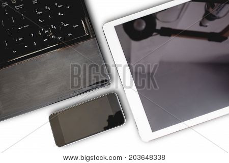 Group of modern electronic devices, computer laptop, digital tablet and mobile smart phone,isolated on white background. Clipping path devices screen