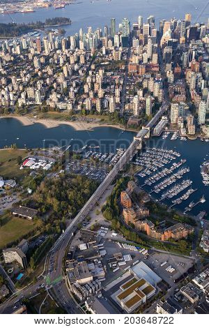 Aerial city view of Downtown Vancouver Burrard Bridge and False Creek. Picture taken in British Columbia Canada during a sunny evening.