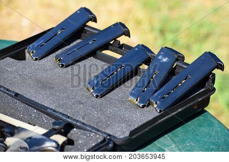 Magazines of handguns in a row outdoor