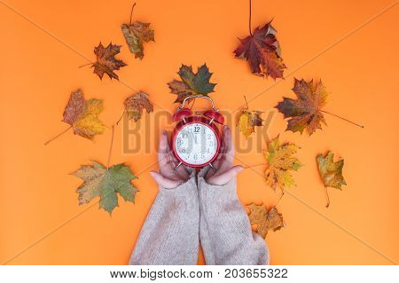 Above View At Hands Holding Alarm Clock