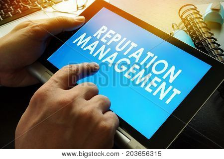 Reputation management on a screen of tablet.
