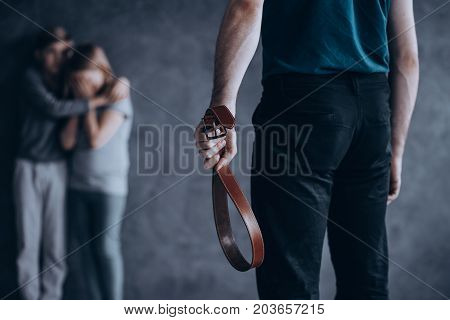 Abusive Father Holding Leather Belt