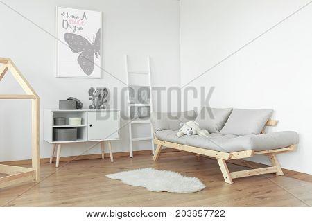 White Teddy Bear On Grey Sofa