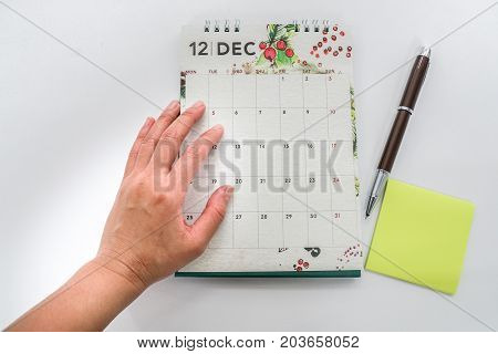 close up businesswoman plan appointment and meeting on December calendar