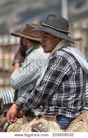 June 10 2017 Toacazo Ecuador: local cowboys sitting in saddle waiting for the rodeo to start