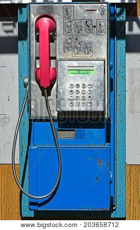 Old obsolete street phone in the city