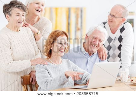 Elderly People Looking At Laptop