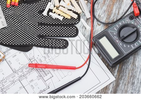 Black Construction Gloves, Drawings And Multimeter, Wooden Background