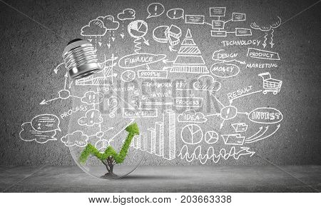 Lightbulb with green growing graph inside placed against sketched business plan information on grey wall. 3D rendering.